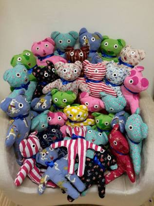 Stuffed bears ready to be given to students in Guizhao